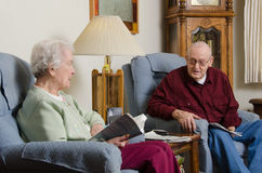 Elderly Discussion. An elderly couple in their eighties having a discussion in their living room Stock Photo