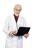 The elderly doctor with the laptop Stock Image