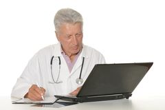 Elderly doctor with a laptop Royalty Free Stock Photography