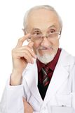 The elderly doctor looks aside Royalty Free Stock Photo