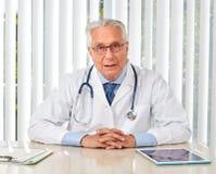 Elderly doctor man in hospital. Stock Photography