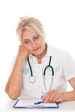 Elderly doctor sitting Stock Images