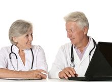 Elderly doctors with a laptop Royalty Free Stock Photo