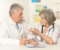 Elderly doctors working Royalty Free Stock Photo