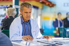 Elderly domino player Stock Image