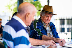 Elderly domino player Royalty Free Stock Photo