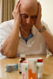 Elderly Drugs. Elderly man with all his pills and drugs Royalty Free Stock Images