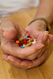 Elderly Drugs. Elderly man with all his pills and drugs Stock Photography