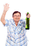 Elderly drunk woman with bottle of alcohol Stock Photo