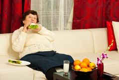 Elderly eating sandwich home Royalty Free Stock Image