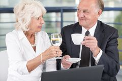 Elderly entrepreneurs during meeting Stock Photo