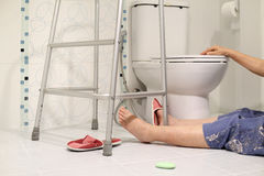 Elderly falling in bathroom because slippery Stock Photos