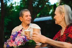 Elderly family couple talking and drinking tea ih the cafe on th stock image