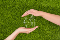 Elderly Family life insurance. Two Woman's open hands making a protection gesture  isolated on green background.Family life insurance, protecting family, family Royalty Free Stock Photos