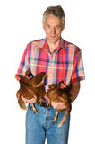 Elderly farmer with chicken Royalty Free Stock Photo
