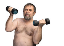 Elderly fat man exercising with dumbbells. An elderly fat man exercising with dumbbells isolated on white with copyspace stock photography