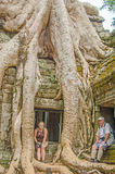 Elderly father and daughter in Angkor Wat complex Stock Image