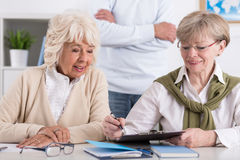 Elderly female friends studying together Stock Photo