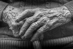 Elderly female hands manicure and cane Royalty Free Stock Image