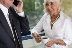 Elderly female office worker Stock Photo