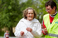 Elderly female participant of XXI Moscow supermarathon Royalty Free Stock Photo