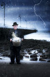 Elderly Fisherman Holding A Bucket Of Fish Stock Images