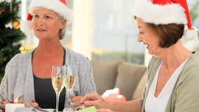 Elderly friends eating cake to celebrate a birthday. In the dinning room stock footage