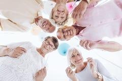 Elderly friends have fun stock photos