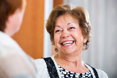 Elderly friends having nice conversation Royalty Free Stock Image