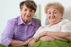 Elderly friends. Portrait of two happy elderly friends Royalty Free Stock Images
