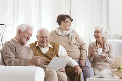 Elderly friends relaxing royalty free stock images