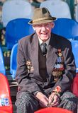 Elderly funny veteran of World War II. Tyumen, Russia - May 9. 2009: Victory Day in Tyumen. Elderly funny veteran of World War II sits on tribune waiting for stock photos