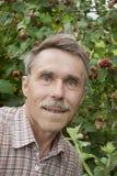 An elderly gardener in the garden Stock Photos