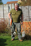 Elderly gardener and his tools. Stock Photography