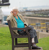 Elderly gent using mobile phone device Royalty Free Stock Images