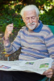 Elderly gentleman reading the paper Royalty Free Stock Image