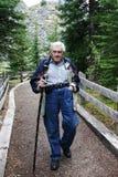 Elderly Gentleman walking. Elderly gentleman hiking on a path at Moraine Lake Royalty Free Stock Image