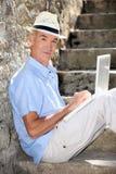 Elderly gentleman working outdoors Stock Photo