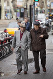 Elderly gentlemen walking in the city center. Barcelona, Spain Royalty Free Stock Image