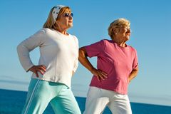 Elderly girls stretching outdoors. Royalty Free Stock Photo