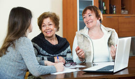 Elderly glad women making will at public notary office Stock Photos