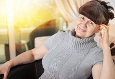 Elderly good looking woman. Portrait in domestic interior Stock Photo