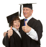 Elderly graduates Stock Images