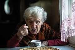 An elderly pensioner woman drinking tea at home. royalty free stock photography