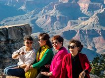 Elderly Group Of Asian Women Tourists Posing For Photos At The Grand Canyon South Side Arizona Royalty Free Stock Image