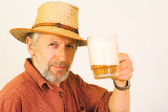 Elderly guy with a mug of beer Stock Images