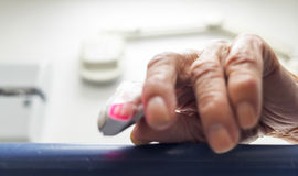 Elderly Hand With a Pulse Meter royalty free stock photography