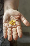 Elderly hand with supplement Stock Images