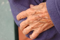 Elderly hands. Elderly woman's hands stock image
