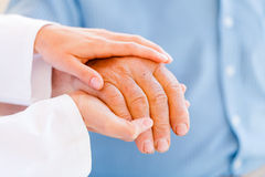Elderly hands. Giving helping hands for needy elderly people stock photo